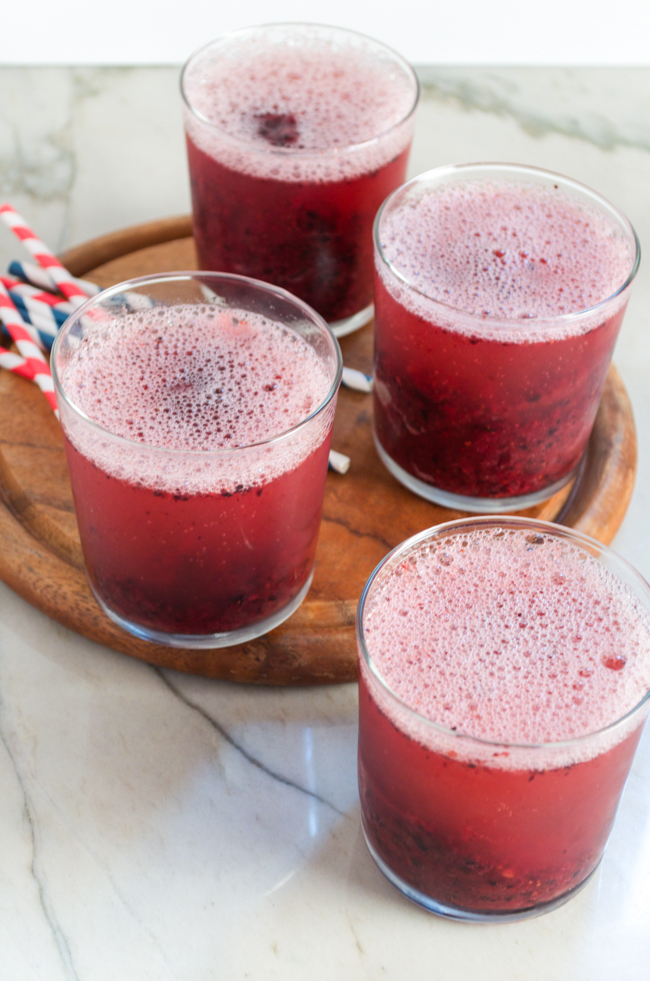 Mixed Berry Sorbet and Champagne Floats, perfect for any celebration! From www.sprinkledsideup.com