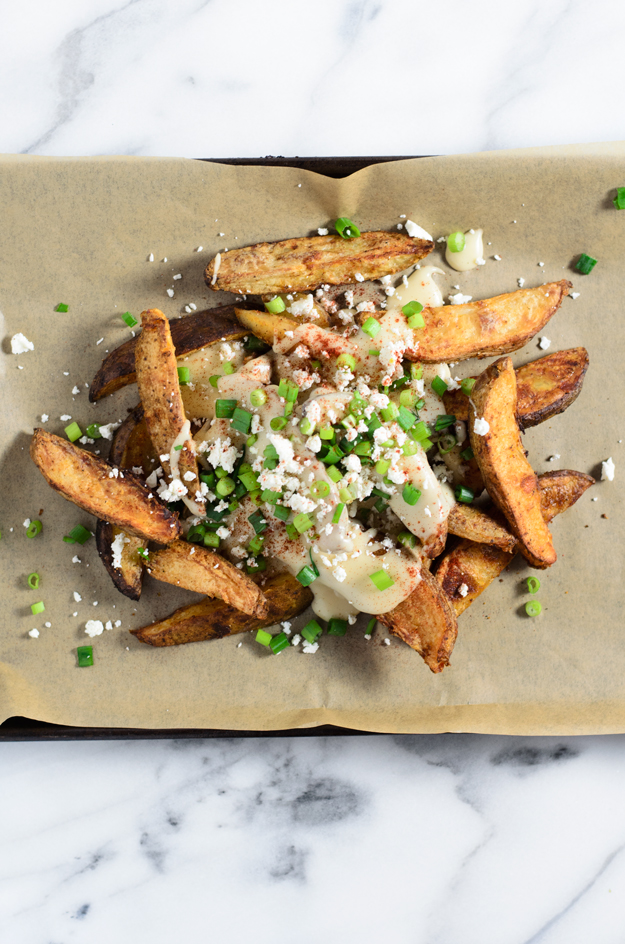 Cheese Fries: Paprika Roasted Potato Wedges with Beer Cheese, Scallions and Feta from www.sprinkledsideup.com