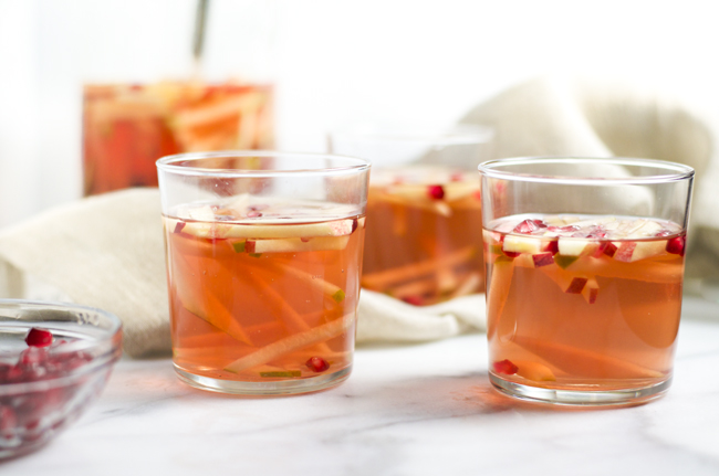 Easy Fall Sangria packed with apples, pears, pomegranates and white grape juice from www.sprinkledsideup.com