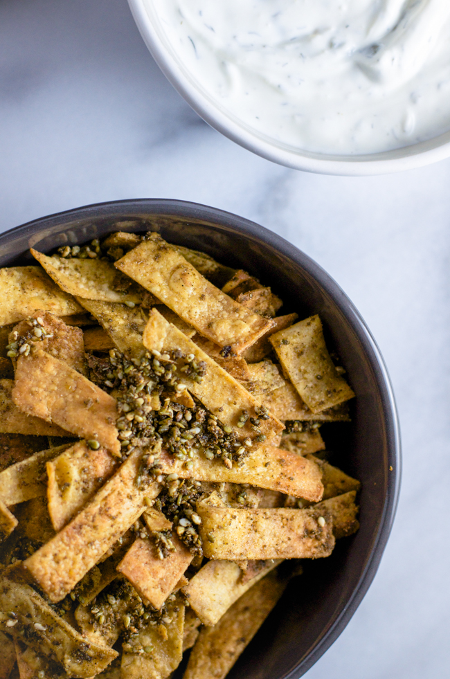 Make homemade Fritos (because it's so easy!) and then toss them in bright, lemony za'atar. Recipe from www.sprinkledsideup.com
